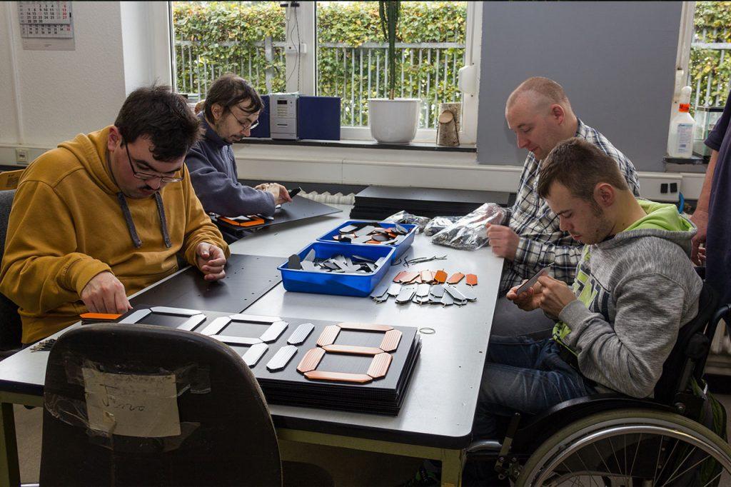 Team at Lebenshilfe Aachen assembling the scoreboards.